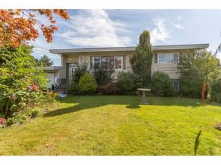 "Photo 1: 10096 BONAVISTA Street in Chilliwack: Fairfield Island House for sale in ""FAIRFIELD ISLAND"" : MLS®# R2478989"