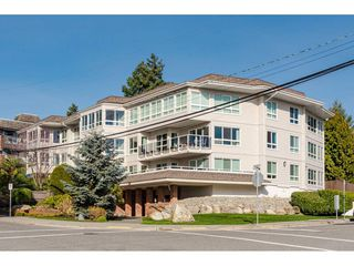 """Photo 1: 104 1322 MARTIN Street: White Rock Condo for sale in """"Blue Spruce"""" (South Surrey White Rock)  : MLS®# R2441551"""