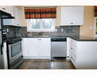 Photo 6: 12302 FLETCHER Street in Maple_Ridge: East Central House for sale (Maple Ridge)  : MLS®# V688409
