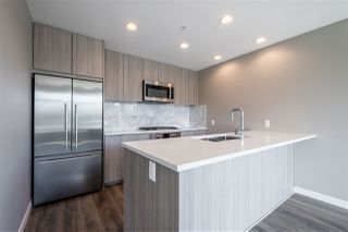 "Photo 9: 100 3289 RIVERWALK Avenue in Vancouver: South Marine Condo for sale in ""R & R"" (Vancouver East)  : MLS®# R2470251"