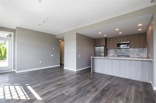 "Photo 7: 100 3289 RIVERWALK Avenue in Vancouver: South Marine Condo for sale in ""R & R"" (Vancouver East)  : MLS®# R2470251"