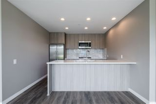 "Photo 8: 100 3289 RIVERWALK Avenue in Vancouver: South Marine Condo for sale in ""R & R"" (Vancouver East)  : MLS®# R2470251"