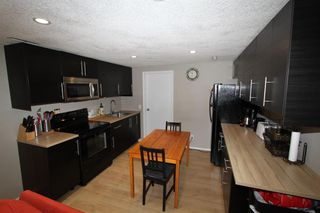 Photo 11: 2438 ELMWOOD Drive SE in Calgary: Southview Detached for sale : MLS®# A1013187