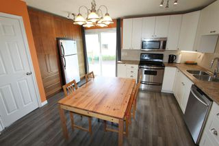 Photo 2: 2438 ELMWOOD Drive SE in Calgary: Southview Detached for sale : MLS®# A1013187