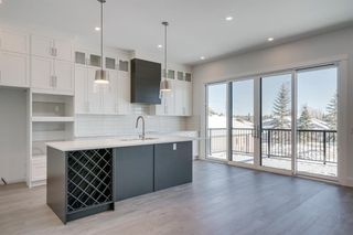 Photo 7: 154 69 Street SW in Calgary: Strathcona Park Detached for sale : MLS®# A1054727