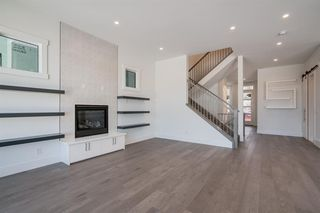 Photo 15: 154 69 Street SW in Calgary: Strathcona Park Detached for sale : MLS®# A1054727