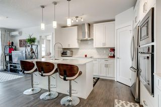Photo 4: 114 20 WALGROVE Walkway SE in Calgary: Walden Apartment for sale : MLS®# A1016101
