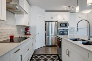 Photo 8: 114 20 WALGROVE Walkway SE in Calgary: Walden Apartment for sale : MLS®# A1016101