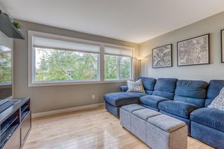 Photo 3: 836A 68 Avenue SW in Calgary: Kingsland Row/Townhouse for sale : MLS®# A1042636