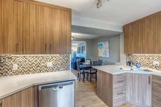 Photo 9: 836A 68 Avenue SW in Calgary: Kingsland Row/Townhouse for sale : MLS®# A1042636