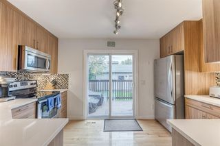 Photo 10: 836A 68 Avenue SW in Calgary: Kingsland Row/Townhouse for sale : MLS®# A1042636