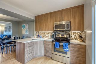 Photo 7: 836A 68 Avenue SW in Calgary: Kingsland Row/Townhouse for sale : MLS®# A1042636