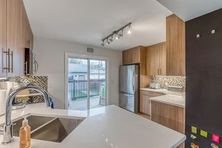 Photo 11: 836A 68 Avenue SW in Calgary: Kingsland Row/Townhouse for sale : MLS®# A1042636