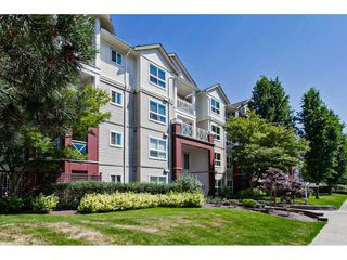 """Photo 2: 122 8068 120A Street in Surrey: Queen Mary Park Surrey Condo for sale in """"Melrose Place"""" : MLS®# R2411416"""