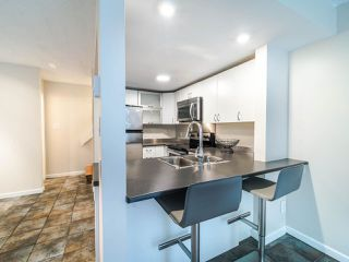 """Photo 5: 105 1922 W 7TH Avenue in Vancouver: Kitsilano Townhouse for sale in """"MAPLE GARDENS"""" (Vancouver West)  : MLS®# R2506845"""