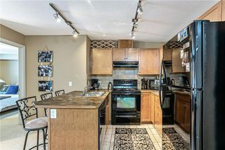 Photo 7: 3215 92 CRYSTAL SHORES Road: Okotoks Apartment for sale : MLS®# C4301331
