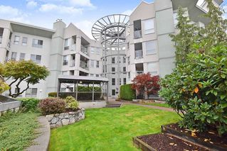 "Photo 1: 406 2585 WARE Street in Abbotsford: Central Abbotsford Condo for sale in ""The Maples"" : MLS®# R2411293"