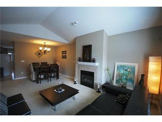 Photo 3: 408 3000 RIVERBAND Drive in COQITLAM: House for sale : MLS®# V880113