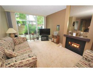 Photo 2: 3913 PENDER ST in Burnaby: Condo for sale : MLS®# V897346