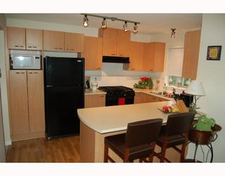 """Photo 2: 103 2968 SILVER SPRINGS Boulevard in Coquitlam: Westwood Plateau Condo for sale in """"TAMARISK AT SILVER SPRINGS"""" : MLS®# V672702"""