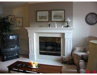 "Photo 1: 101 7837 120A Street in Surrey: West Newton Townhouse for sale in ""Berkshyre Gardens"" : MLS®# F2812158"