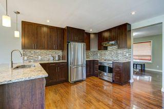 Photo 6: 329 HIDDEN VALLEY Place NW in Calgary: Hidden Valley Detached for sale : MLS®# C4305707