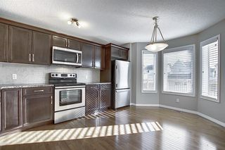 Photo 6: 240 ELGIN MEADOWS Gardens SE in Calgary: McKenzie Towne Semi Detached for sale : MLS®# A1014600