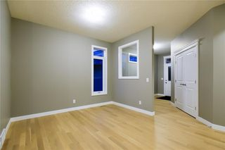 Photo 5: 30 SILVERADO CREST Bay SW in Calgary: Silverado Detached for sale : MLS®# A1019218