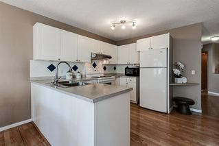Photo 7: 169 BRIDLEGLEN Road SW in Calgary: Bridlewood Detached for sale : MLS®# A1031006
