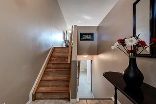Photo 5: 169 BRIDLEGLEN Road SW in Calgary: Bridlewood Detached for sale : MLS®# A1031006