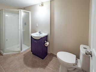 Photo 32: 153 Panatella Park NW in Calgary: Panorama Hills Row/Townhouse for sale : MLS®# A1043030