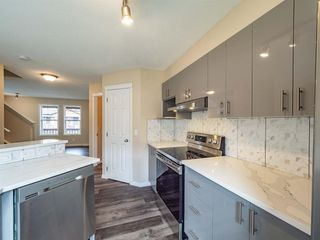 Photo 5: 153 Panatella Park NW in Calgary: Panorama Hills Row/Townhouse for sale : MLS®# A1043030