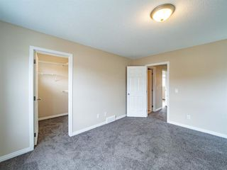 Photo 22: 153 Panatella Park NW in Calgary: Panorama Hills Row/Townhouse for sale : MLS®# A1043030