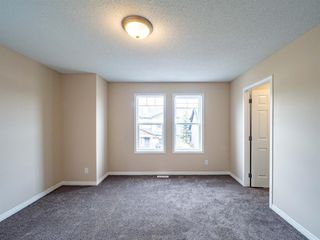 Photo 21: 153 Panatella Park NW in Calgary: Panorama Hills Row/Townhouse for sale : MLS®# A1043030