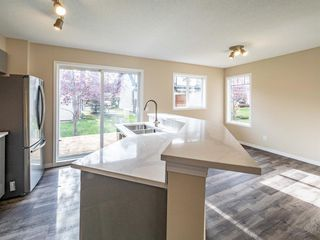 Photo 10: 153 Panatella Park NW in Calgary: Panorama Hills Row/Townhouse for sale : MLS®# A1043030