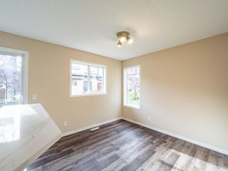 Photo 11: 153 Panatella Park NW in Calgary: Panorama Hills Row/Townhouse for sale : MLS®# A1043030