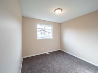 Photo 24: 153 Panatella Park NW in Calgary: Panorama Hills Row/Townhouse for sale : MLS®# A1043030