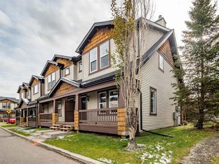 Photo 1: 153 Panatella Park NW in Calgary: Panorama Hills Row/Townhouse for sale : MLS®# A1043030