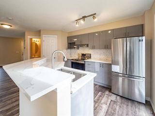 Photo 6: 153 Panatella Park NW in Calgary: Panorama Hills Row/Townhouse for sale : MLS®# A1043030