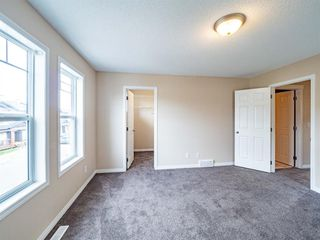 Photo 20: 153 Panatella Park NW in Calgary: Panorama Hills Row/Townhouse for sale : MLS®# A1043030