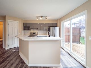 Photo 8: 153 Panatella Park NW in Calgary: Panorama Hills Row/Townhouse for sale : MLS®# A1043030