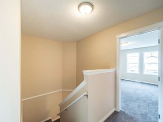Photo 19: 153 Panatella Park NW in Calgary: Panorama Hills Row/Townhouse for sale : MLS®# A1043030
