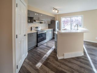 Photo 4: 153 Panatella Park NW in Calgary: Panorama Hills Row/Townhouse for sale : MLS®# A1043030
