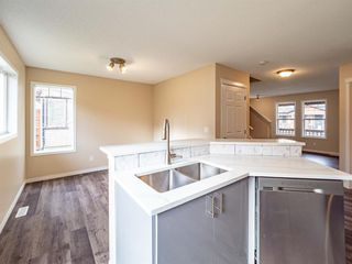 Photo 7: 153 Panatella Park NW in Calgary: Panorama Hills Row/Townhouse for sale : MLS®# A1043030
