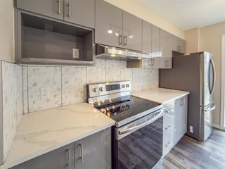 Photo 9: 153 Panatella Park NW in Calgary: Panorama Hills Row/Townhouse for sale : MLS®# A1043030