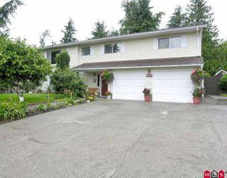 Photo 1: 18235 57A AV in Surrey: Cloverdale BC House for sale (Cloverdale)  : MLS®# F2514259