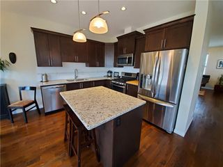 Photo 7: 118 WILLIAMSTOWN Park NW: Airdrie Row/Townhouse for sale : MLS®# C4301583