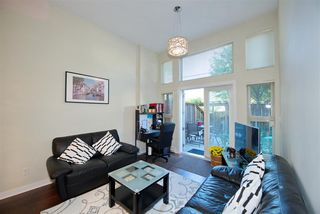 "Photo 1: 102 3688 INVERNESS Street in Vancouver: Knight Condo for sale in ""Charm"" (Vancouver East)  : MLS®# R2488351"