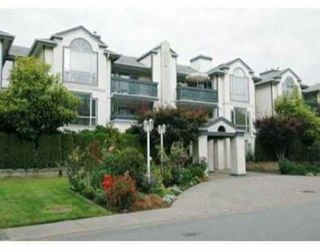 """Photo 1: 19121 FORD Street in Pitt Meadows: Central Meadows Condo for sale in """"EDGEFORD MANOR"""" : MLS®# V635143"""