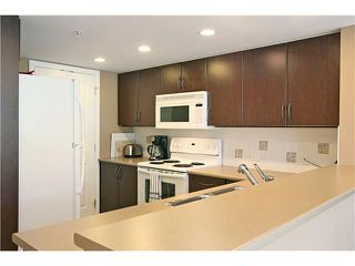 """Photo 2: # 801 290 NEWPORT DR in Port Moody: North Shore Pt Moody Condo for sale in """"THE SENTINAL"""" : MLS®# V855050"""